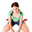 Pretty girl in shorts kneeling on the floor. — Stock Photo #3395490