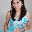 Asian girl with flute. — Stock Photo