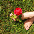 Woman feet with rose. — Stock Photo