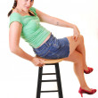 Pretty girl sitting on bar chair. — Stock Photo