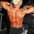 Bodybuilding woman back. — Stock Photo