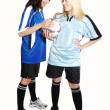 Stock Photo: Two soccer girls with ball.