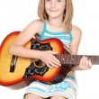 Young blond girl with guitar. — Stock Photo