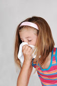 Young girl sneezing. — Stock Photo