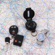 Roadmap with car keys, compass and watch. - Stock Photo