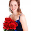 Pretty girl with red roses. — Stock Photo