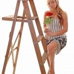 Girl on stepladder. — Stock Photo #3486340