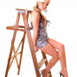 Girl on stepladder. — Stockfoto