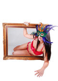 Masked woman in picture frame. — Stock Photo