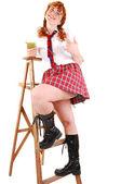 Schoolgirl on stepladder. — Stock Photo