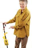 Senior woman with cane. — Stock Photo
