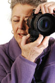 Senior lady with camera. — Stock Photo