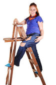 Pretty girl on the stepladder. — Stock Photo