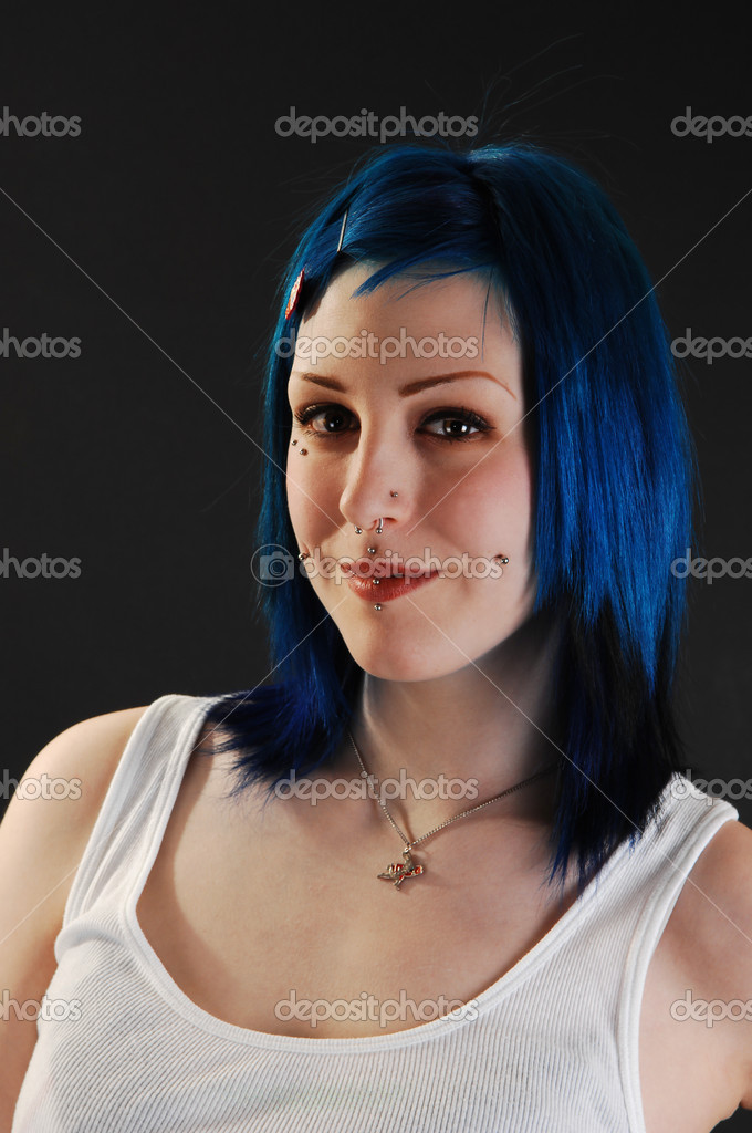 An heath shoot of a young smiling girl in a white t-shirt and bright bluehair on black background. — Stock Photo #3522876