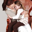 Mother and daughter in Armchair. - Foto Stock