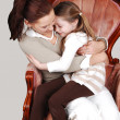 Stock Photo: Mother and daughter in Armchair.