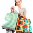 An very surprised shopping woman. — Stockfoto