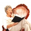 Senior woman reading. - Foto Stock