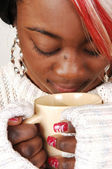 Young Jamaican woman with coffee. — Stock Photo