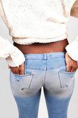 Girl holding her butt. — Stock Photo