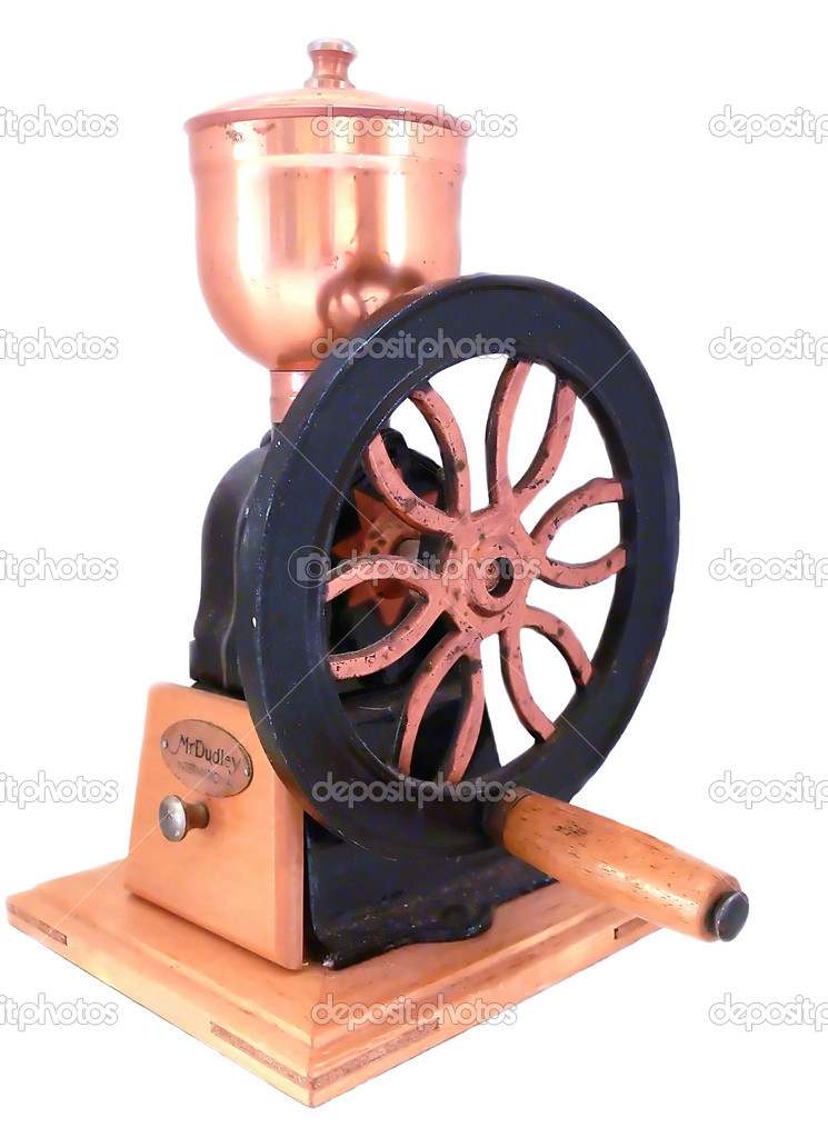 An old antique coffee grinder with hand wheel over white background. — Stock Photo #3600501