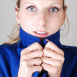 Pretty lady in blue coat. — Stock Photo #3814122