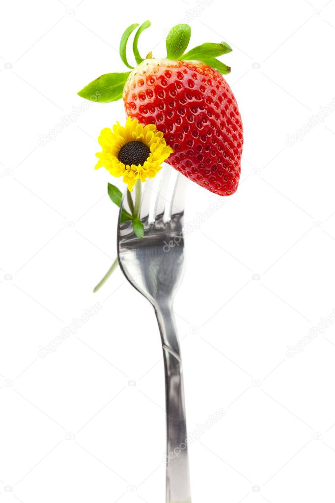 Strawberry and flower on a fork isolated on white — Stock Photo #3234614
