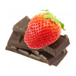 Strawberry on the mountain of chocolate - Stock Photo