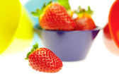 Strawberries in a blue bowl isolated on white — Stock Photo