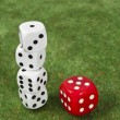 Piled dice and red die — Stock Photo