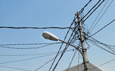Streetlight pole with cables — Stock Photo