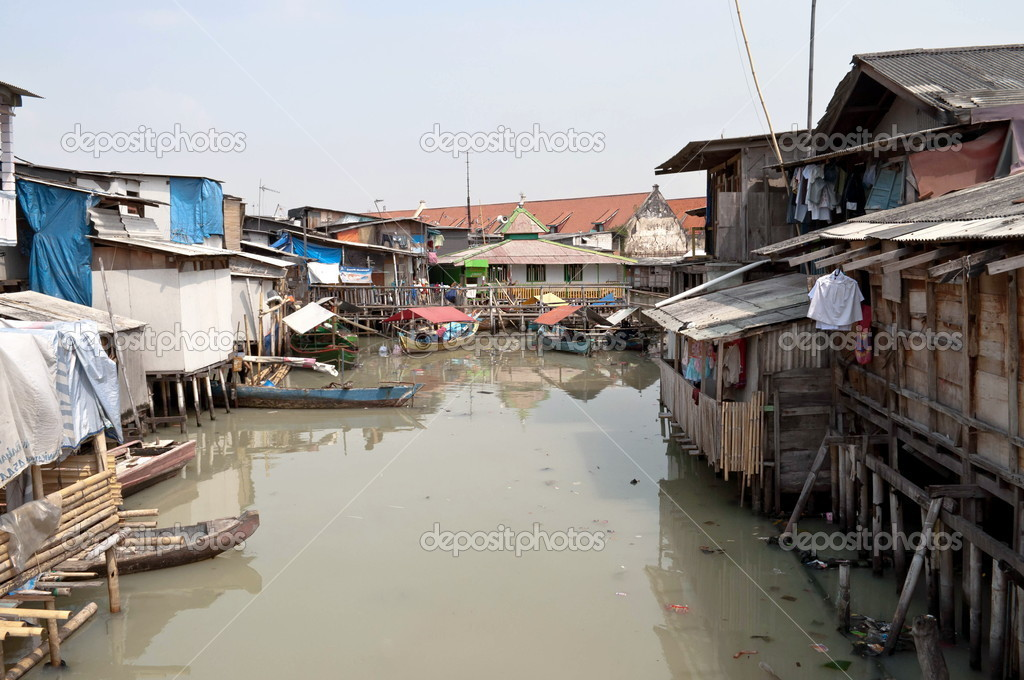 Slum on dirty canal in Jakarta, Indonesia  Stock Photo #3919751