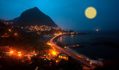 Night scense with road tracking and moon — Stockfoto
