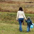 Woman and boy on the meadow — Stock Photo