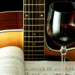 Guitar, book and wineglass — Stock Photo #3243562