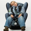 Boy sleeps in safe auto chair — Stock Photo #3243582