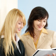 Blonde and brunette women in the office — Stock Photo #3244273