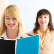 Blonde and brunette women in office — Stock Photo #3244279