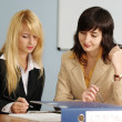 Blonde and brunette women in office — Stock Photo #3244283