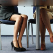 Legs of women under table — Stock Photo #3244288