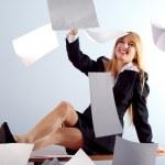 Blonde girl throwing white sheets — Stock Photo #3244293