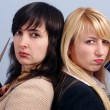 Blonde and brunette women in the office — Stock Photo