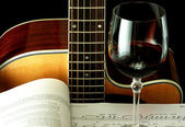 Guitar, book and wineglass — Stock Photo
