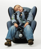 Boy sleeps in safe auto chair — Stock Photo