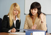 Blonde and brunette women in office — Stock Photo