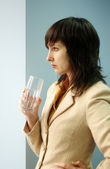 Brunette woman with glass of water — Stock Photo