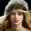 Beutiful blonde in fur hat with naked shoulders — Stock Photo
