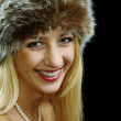 Blonde girl in pearl necklace and fur hat with naked shoulders — Stock Photo #3252676