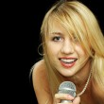Blonde girl with naked shoulders singing karaoke — Stock Photo #3252679