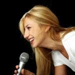Blonde girl singing karaoke — Stock Photo #3252681